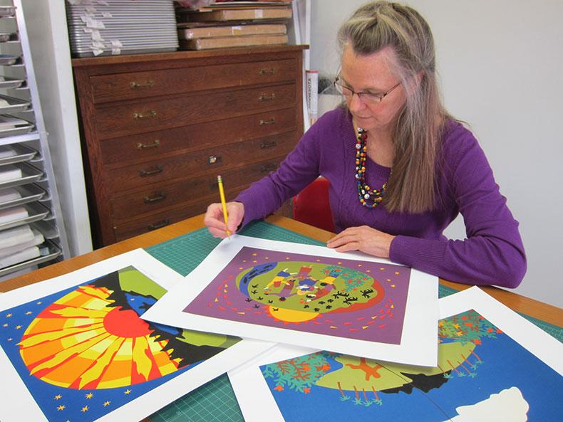 Debra Frasier inscribing art prints